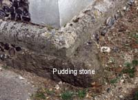 Pudding stone in base of tower